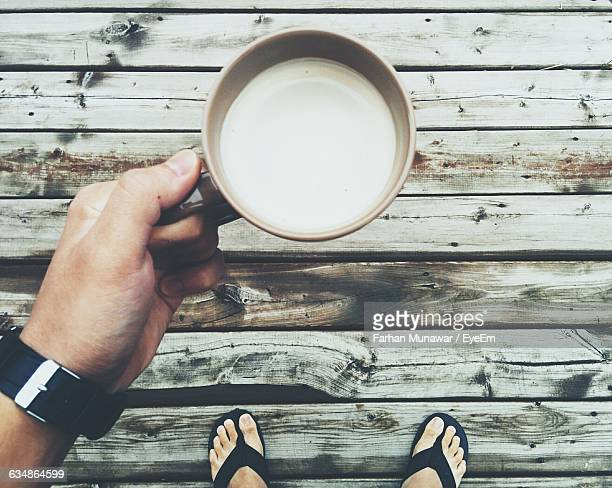 Directly Above Of Man Holding Coffee Cup