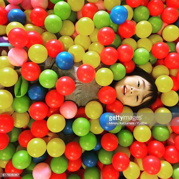 Directly Above Portrait Of Girl In Ball Pool