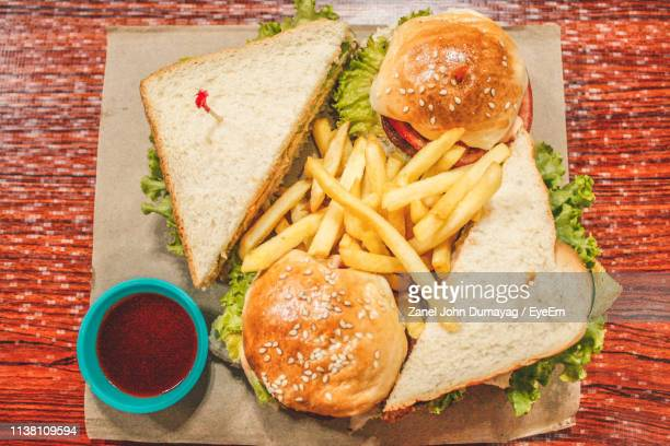 directly above shot burger on table - french fries stock pictures, royalty-free photos & images