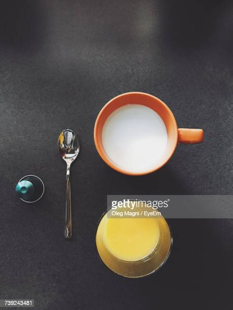 Directly Above Shot Drink Glass With Milk Cup On Table