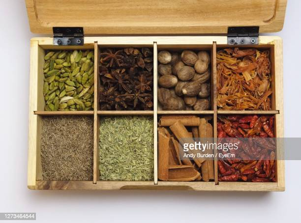 directly above shot of a box of dried spices - malton stock pictures, royalty-free photos & images