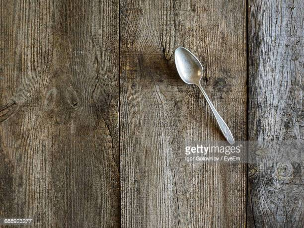 Directly Above Shot Of Abandoned Spoon On Old Table