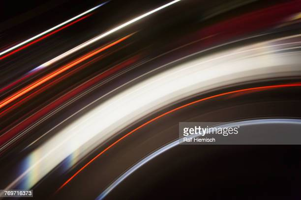 Directly above shot of abstract light trails against black background