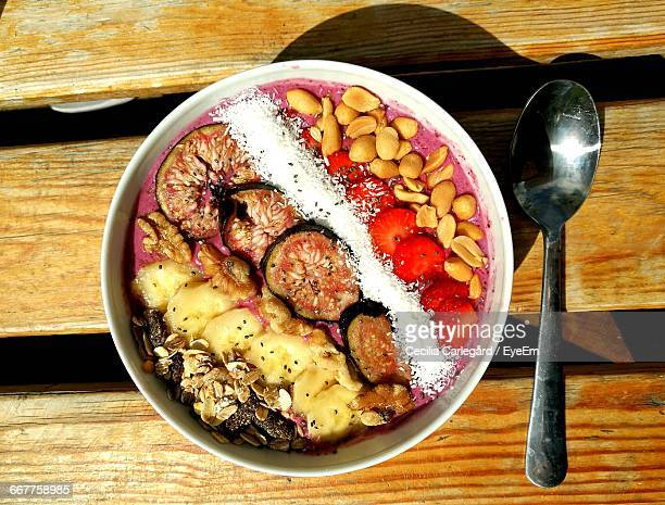 Directly Above Shot Of Acai Bowl With Spoon On Table