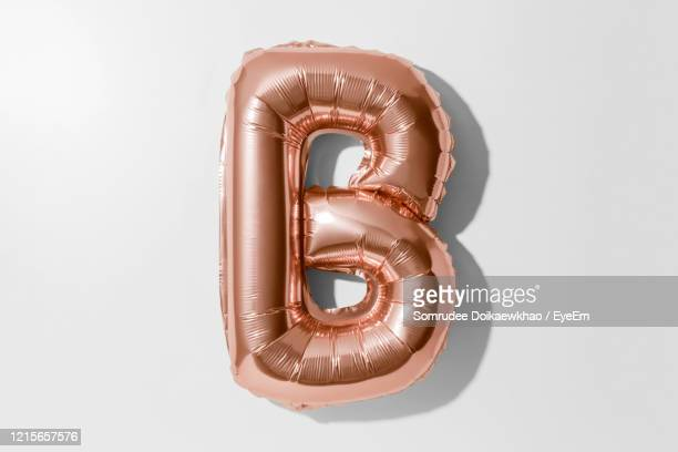 directly above shot of alphabet balloon against white background - monogram stock pictures, royalty-free photos & images