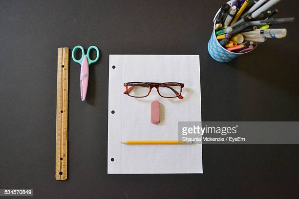 directly above shot of anthropomorphic face made with stationary on table - anthropomorphic stock pictures, royalty-free photos & images