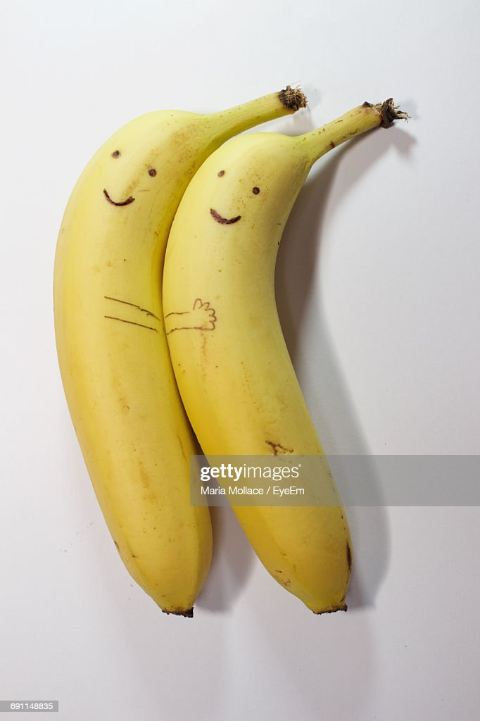 Directly Above Shot Of Anthropomorphic Face On Bananas Over White Background : Foto de stock