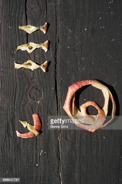 Directly above shot of apple peel and cores on wood