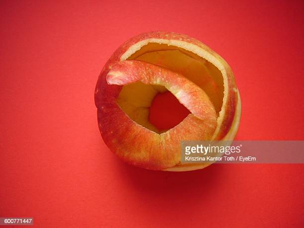 Directly Above Shot Of Apple Peel On Red Background