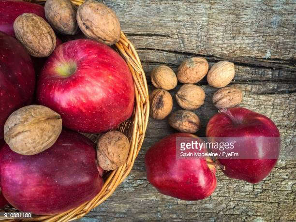 Directly Above Shot Of Apples And Walnuts In Basket On Table