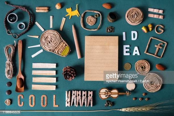directly above shot of art and craft equipment on blue background - knolling concept stock pictures, royalty-free photos & images