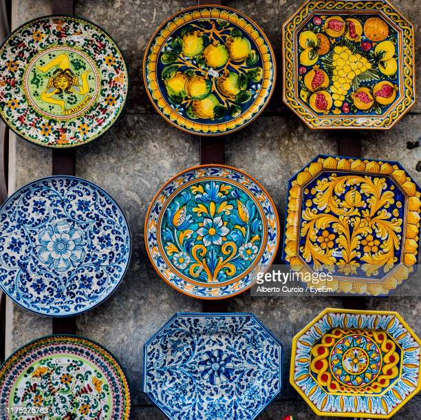 directly above shot of artistic plates on table - taormina stock pictures, royalty-free photos & images