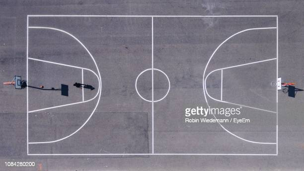 directly above shot of athlete playing at basketball court - basketball stock-fotos und bilder