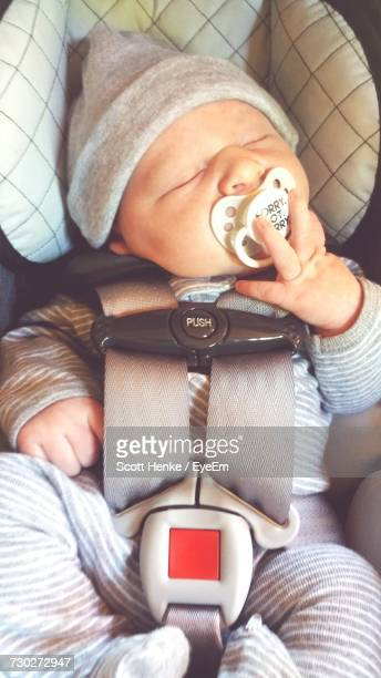 Directly Above Shot Of Baby Boy With Pacifier In Mouth