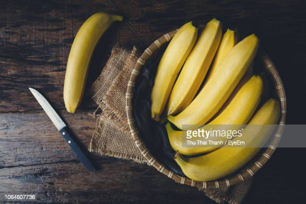 directly above shot of bananas in basket on table - banana stock pictures, royalty-free photos & images