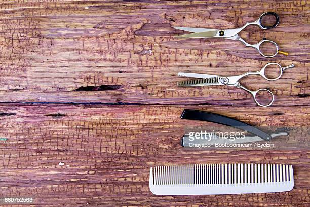 Directly Above Shot Of Barber Equipment On Wooden Table