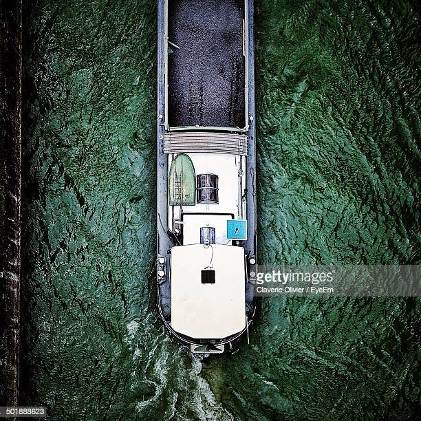 directly above shot of barge in river - barge stock photos and pictures
