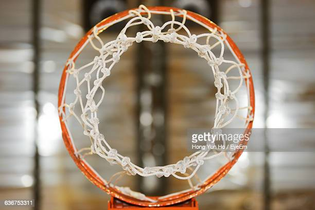 directly above shot of basketball hoop in court - basketball hoop stock pictures, royalty-free photos & images