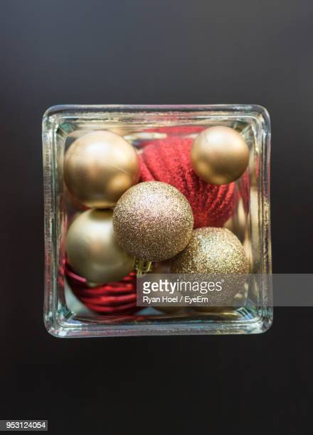 Directly Above Shot Of Baubles In Box Against Black Background