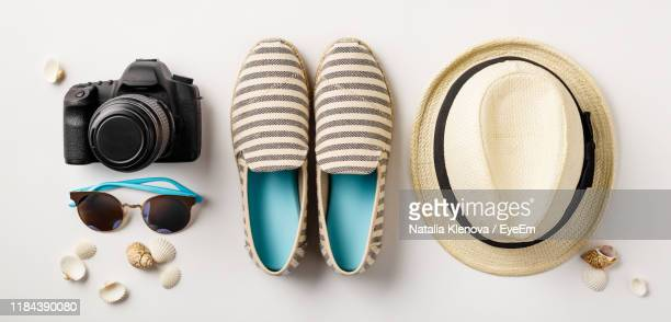 directly above shot of beach supplies on white background - knolling concept stock pictures, royalty-free photos & images