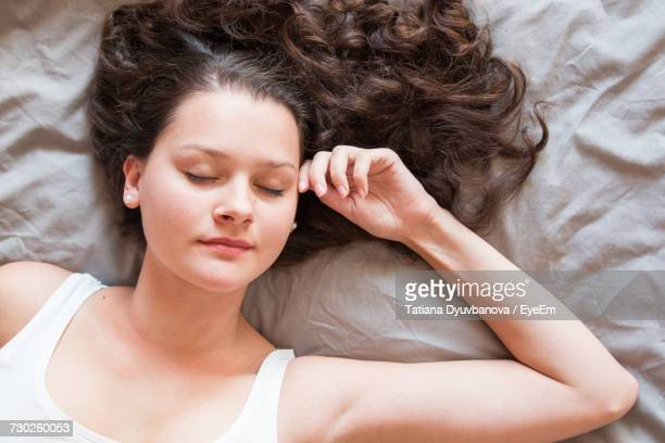 Directly Above Shot Of Beautiful Woman Sleeping On Bed