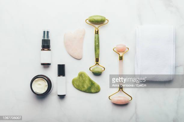 directly above shot of beauty accessory on white background - rose quartz stock pictures, royalty-free photos & images