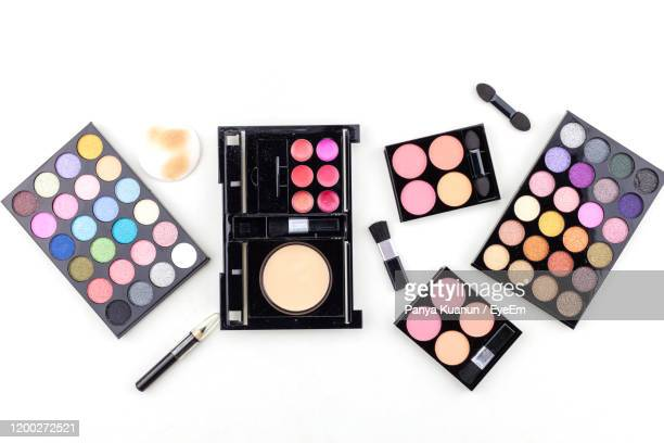 directly above shot of beauty products against white background - eyeshadow stock pictures, royalty-free photos & images