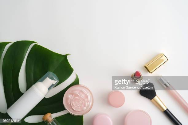 directly above shot of beauty products - cosmetics stock photos and pictures