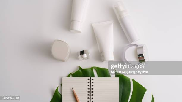 directly above shot of beauty products - cosmetics stock pictures, royalty-free photos & images