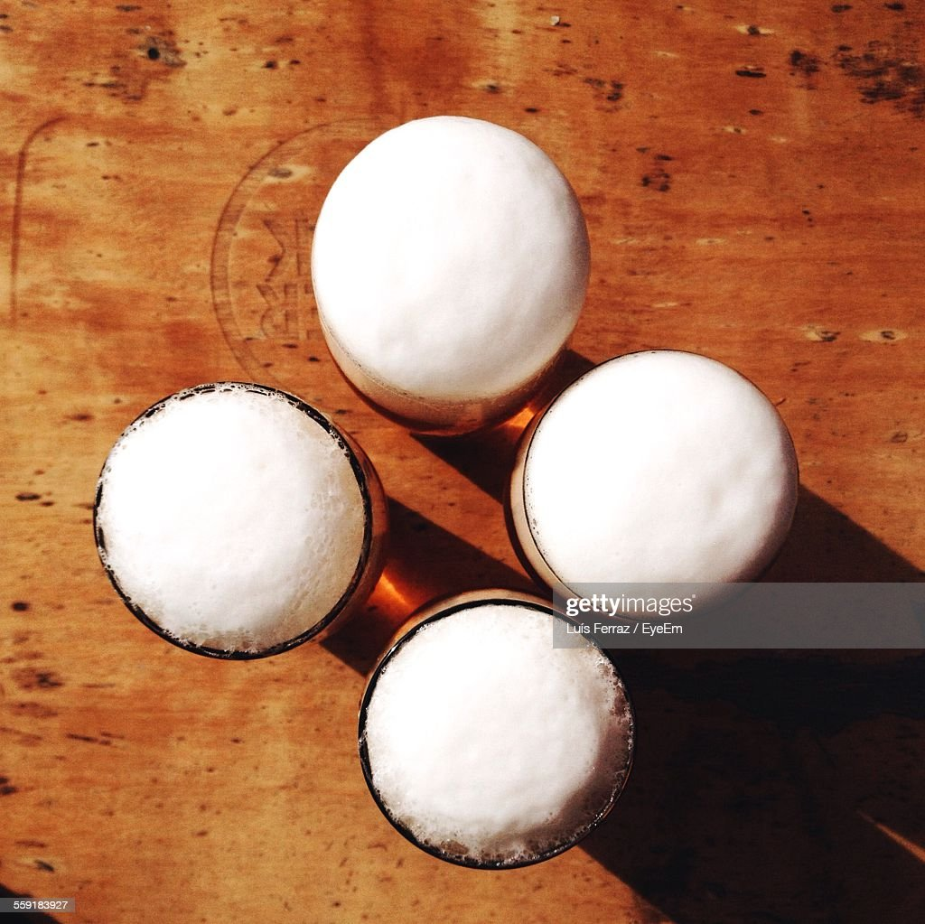 Directly Above Shot Of Beer Glasses On Table : Stock Photo