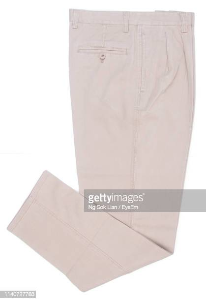 directly above shot of beige pant against white background - beige pants stock pictures, royalty-free photos & images