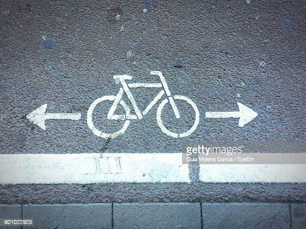 Directly Above Shot Of Bicycle Lane Sign On Road