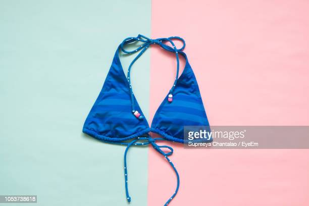directly above shot of bikini top onbackground - swimwear stock pictures, royalty-free photos & images