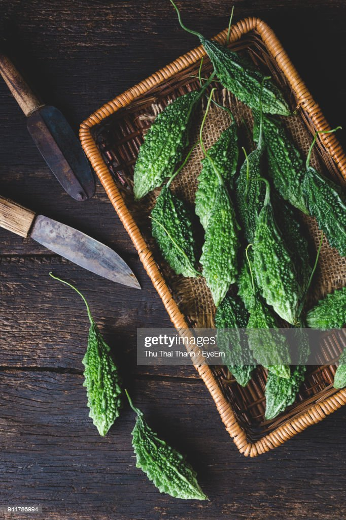 Directly Above Shot Of Bitter Gourds And Baskets On Table : Stock Photo