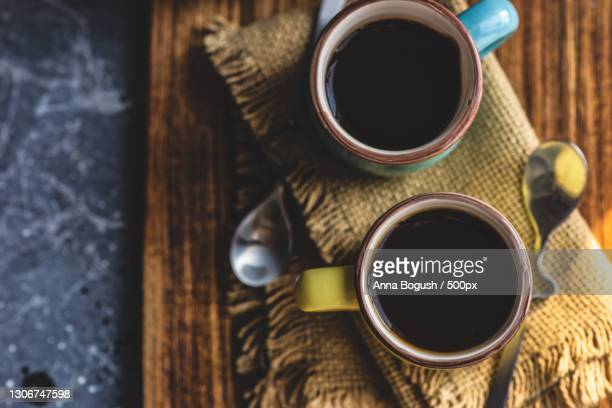 directly above shot of black coffee on table - coffee drink stock pictures, royalty-free photos & images