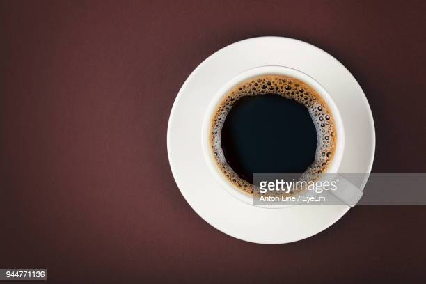 directly above shot of black coffee on table - saucer stock pictures, royalty-free photos & images