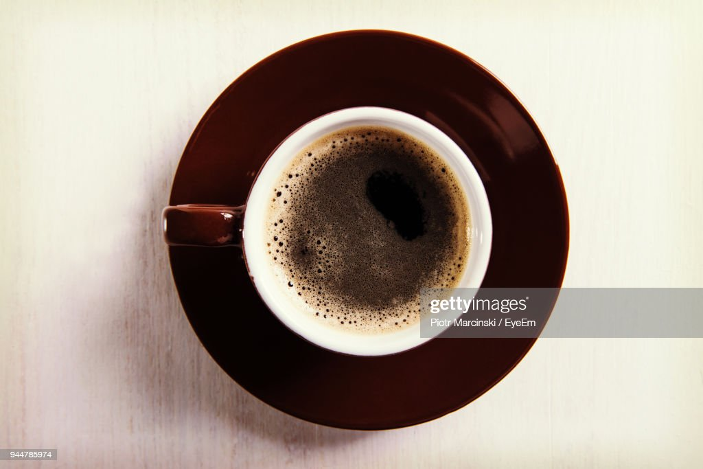 Directly Above Shot Of Black Coffee On Table : Stock Photo