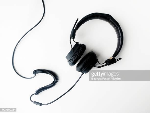Directly Above Shot Of Black Headphones Over White Background