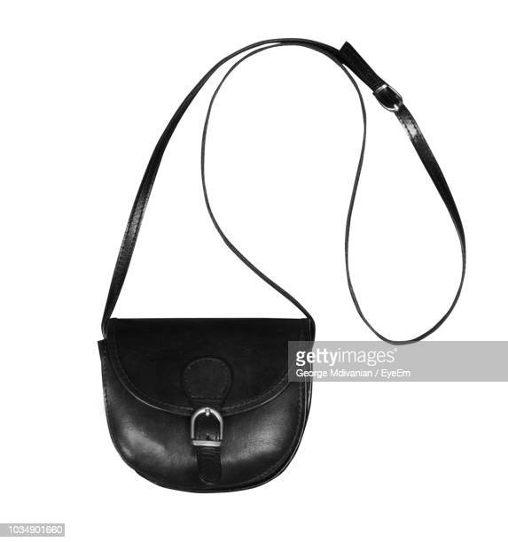 directly above shot of black purse on white background - strap stock pictures, royalty-free photos & images