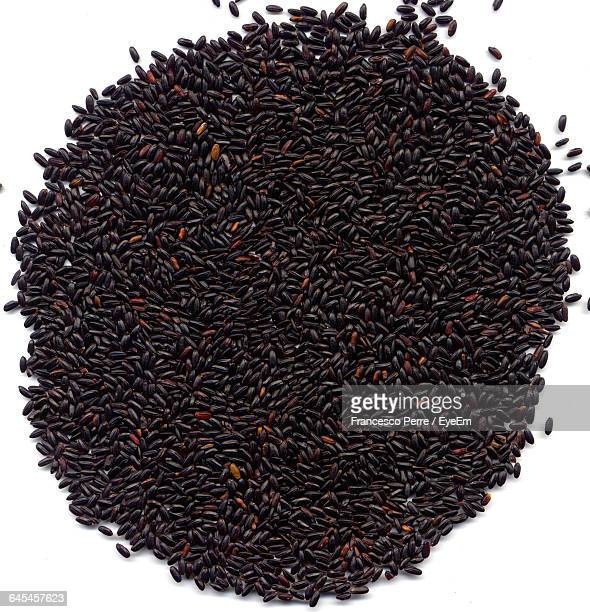 Directly Above Shot Of Black Rice Against White Background