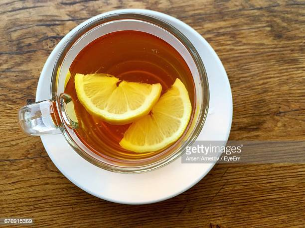 directly above shot of black tea with lemon - herbal tea stock pictures, royalty-free photos & images