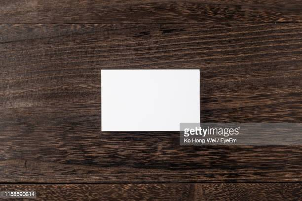 directly above shot of blank business card on table - printed media stock pictures, royalty-free photos & images