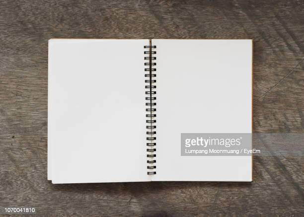 Directly Above Shot Of Blank Open Book On Wooden Table