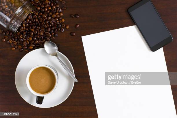 Directly Above Shot Of Blank Paper By Coffee On Table