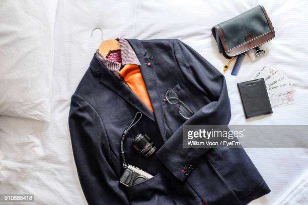 directly above shot of blazer by tickets on bed - menswear stock pictures, royalty-free photos & images