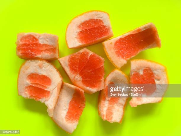 Directly Above Shot Of Blood Oranges Slices On Green Table