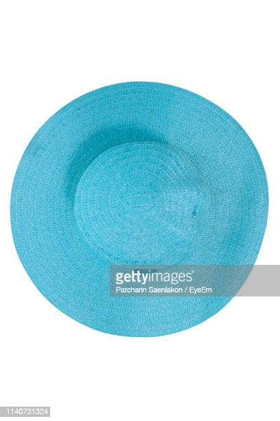 directly above shot of blue hat on white background - white hat fashion item stock photos and pictures