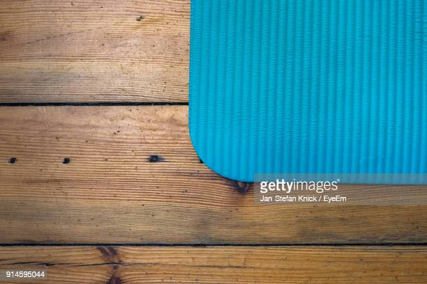 Directly Above Shot Of Blue Place Mat On Wooden Table