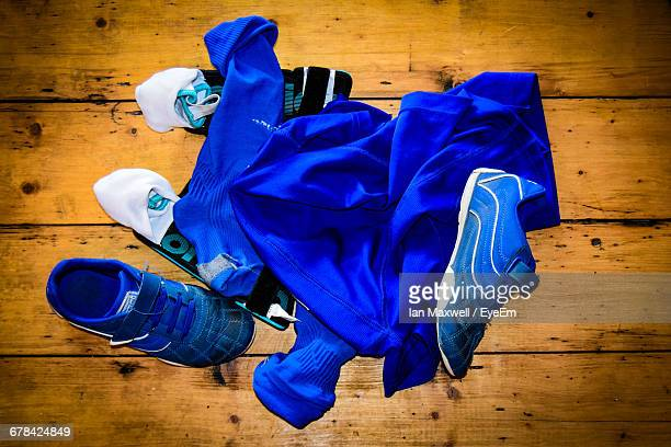 Directly Above Shot Of Blue Soccer Uniform And Shoes On Table
