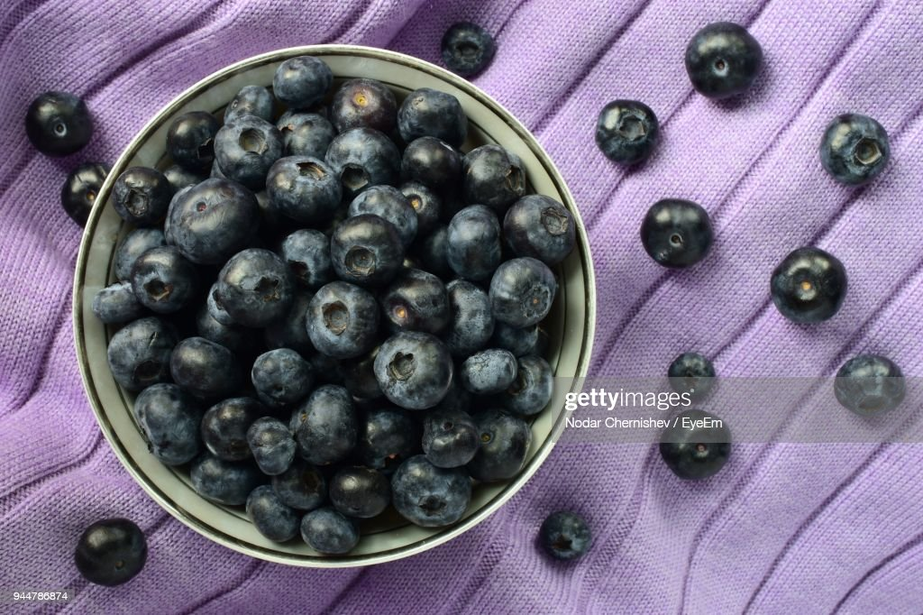 Directly Above Shot Of Blueberries On Purple Fabric : Stock Photo